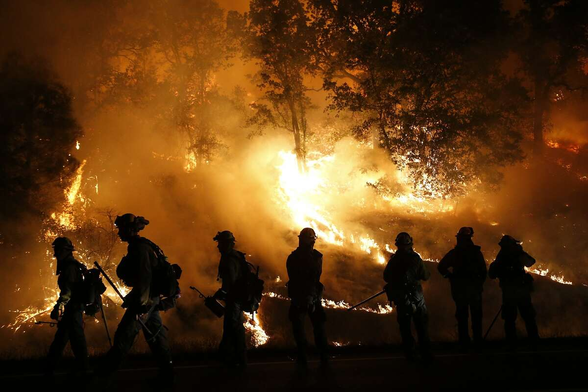MIDDLETOWN, CA - SEPTEMBER 13: Firefighters with the Marin County Fire Department's Tamalpais Fire Crew monitor a backfire as they battle the Valley Fire on September 13, 2015 near Middletown, California. The fast-moving fire has consumed 50,000 acres after it grew 40,000 acres in twelve hours and is currently zero percent contained. (Photo by Stephen Lam/ Getty Images)