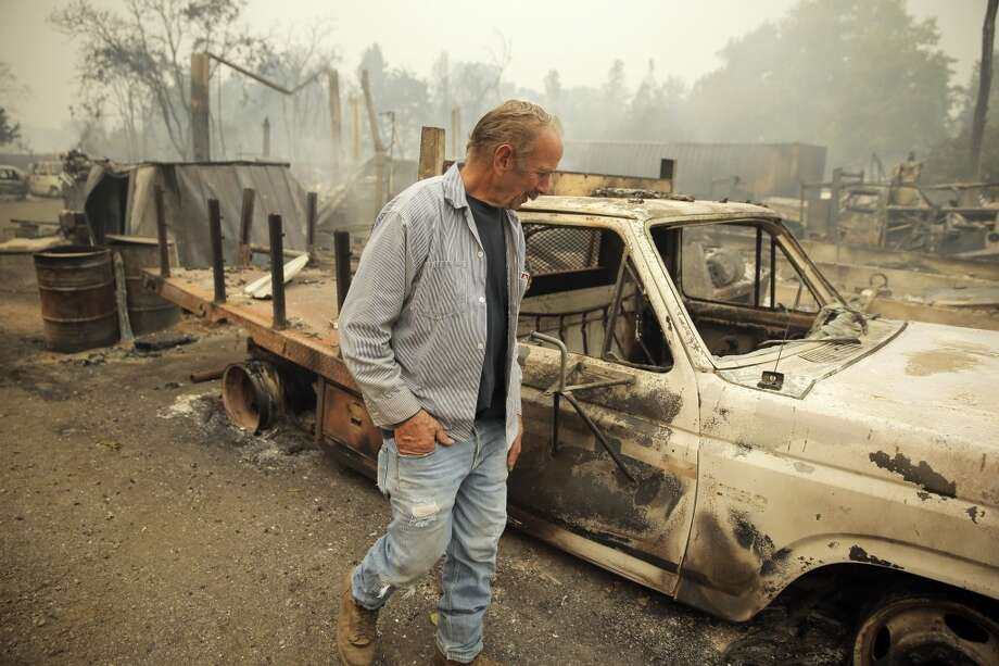 Larry Menzio looks over the remains of his tire shop Menzio Tire in Middletown, Calif., on Sunday, September 13, 2015, the day after a wildfire swept through town destroying hundreds of homes and forcing mass evacuations. Photo: Carlos Avila Gonzalez, The Chronicle