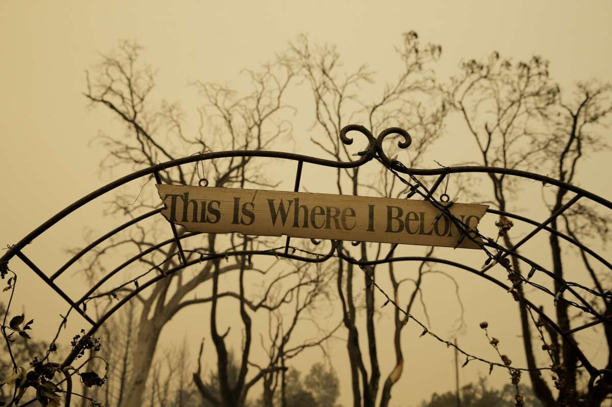 """A sign reading,""""This is where I belong,"""" is all that's left of a destroyed home in Middletown, Calif., on Sunday, September 13, 2015, the day after a wildfire swept through town destroying homes and forcing mass evuations."""