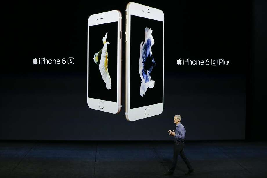 Apple CEO Tim Cook discusses the new iPhone 6s and iPhone 6s Plus during the Apple event at the Bill Graham Civic Auditorium in San Francisco, Wednesday, Sept. 9, 2015. (AP Photo/Eric Risberg) Photo: Eric Risberg, Associated Press