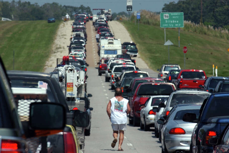 Bruce Crabtree, 49, of Pasadena, ran to catch up with his family on U.S. Highway 96 in Silsbee, when traffic began moving again. Crabtree had stepped out of his vehicle when traffic was at a standstill. Photo: Beaumont Enterprise / THE BEAUMONT ENTERPRISE