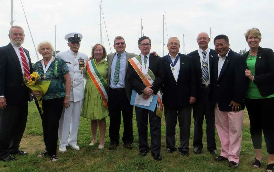A ceremony took place on Perry's Green next to Southport Harbor commemorating the role that Irish-born Commodore John Barry played in support of the American Revolution. Among those attending, from left: Bob Fox of Westport, secretary of Fairfield County Ancient Order of Hibernians; Kay Egan, Danbury Ancient Order of Hibernians; Master Chief Iannucci, USN retired and commander Port 5 Naval Veterans in Bridgeport); James Murray of Weston, president of Fairfield County Ancient Order of Hibernians; Thomas McDonough of Waterbury, president of Connecticut Ancient Order of Hibernians; Thomas Keane of Fairfield, president of Ancient Order of Hibernians JFK Division No. 1 of Bridgeport; Ted Lovely of Trumbull, vice president of Connecticut Ancient Order of Hibernians and USN retired); state Sen. Tony Hwang of Fairfield, and state Rep. Laura Devlin of Fairfield. Photo: Contributed Photo / Fairfield Citizen