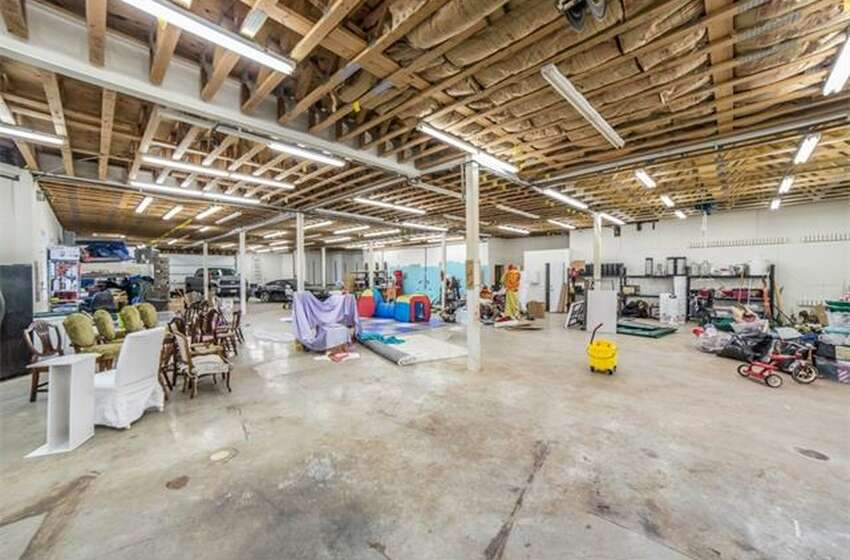 This massive mansion in Austin has a garage that could easily fit about 20 cars inside of it. It also has numerous amenities and a gorgeous view of the Texas Hill Country.