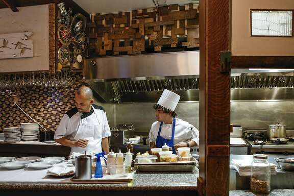 Chef Manny Torres discusses orders with sous chef Wesley Rowell at The Palace on Thursday, Sept. 10, 2015 in San Francisco, Calif.