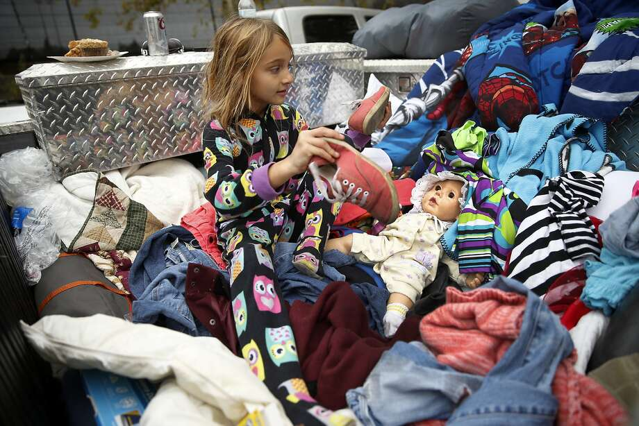 Zayann Nelson, whose family's house in Cpbb was totally destroyed by the Valley Fire, sits in the back of her family's pick up truck at the Napa County Fairgrounds in Calistoga, Calif., on Monday, September 14, 2015. Photo: Scott Strazzante, The Chronicle