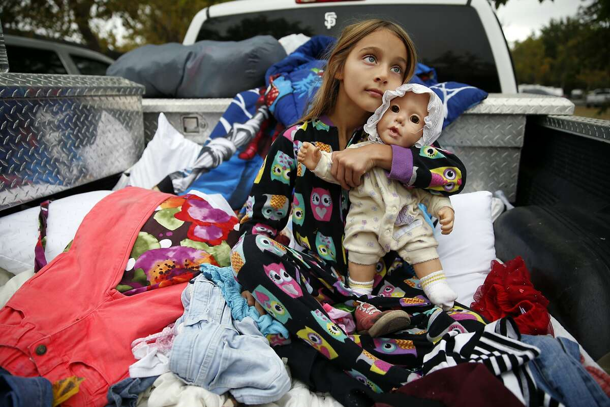 Zayann Nelson, whose family's house in Cpbb was totally destroyed by the Valley Fire, sits in the back of her family's pick up truck at the Napa County Fairgrounds in Calistoga, Calif., on Monday, September 14, 2015.