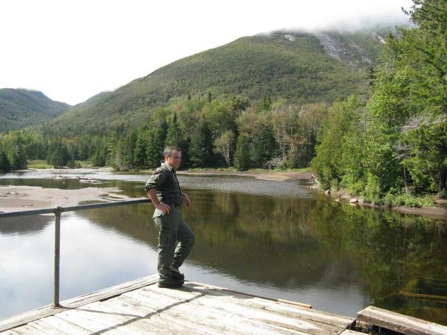 DEC Forest Ranger James Giglinto checks out the damage to Marcy Dam after Tropical Storm Irene in 2011. (Gillian Scott/Times Union archive)