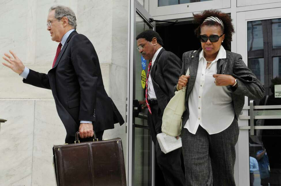 Former state Assemblyman William Scarborough, center, and his attorney E. Stewart Jones, left, leave the Federal Courthouse following Scarborough's sentencing on Monday, Sept. 14, 2015, in Albany, N.Y. (Paul Buckowski / Times Union)