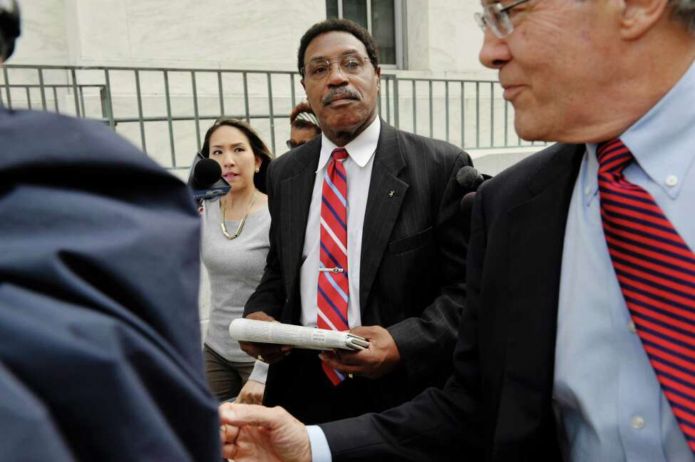 Former state Assemblyman William Scarborough, center, and his attorney E. Stewart Jones, right, leave the Federal Courthouse following Scarborough's sentencing on Monday, Sept. 14, 2015, in Albany, N.Y. (Paul Buckowski / Times Union)