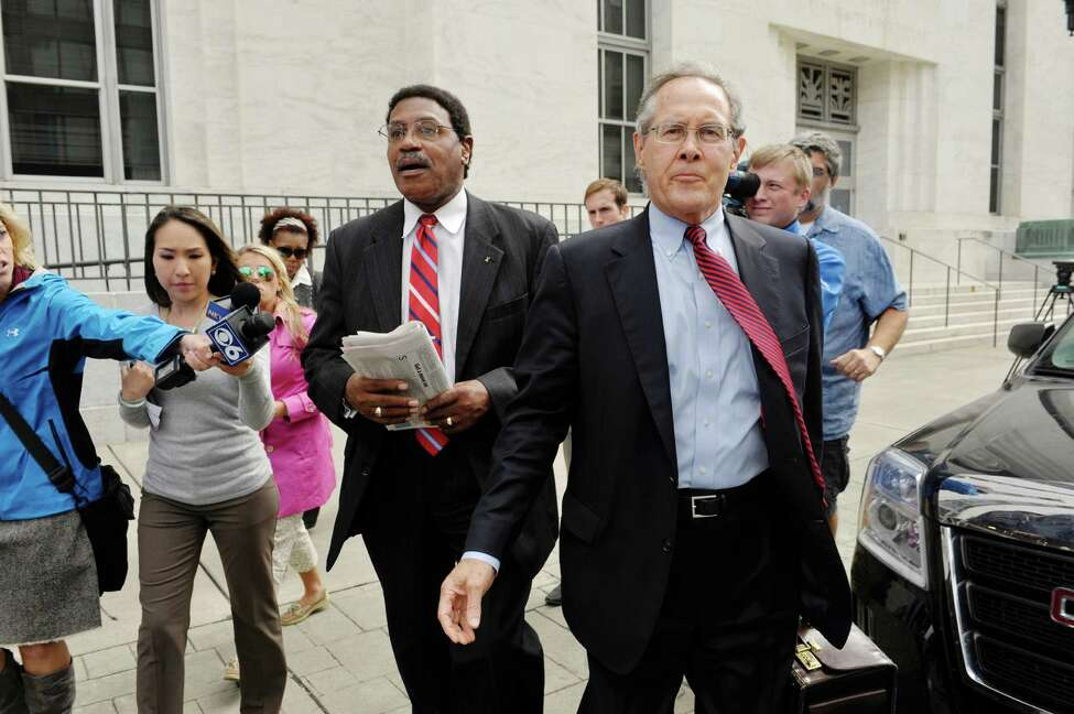Former state Assemblyman William Scarborough, left, and his attorney E. Stewart Jones leave the Federal Courthouse following Scarborough's sentencing on Monday, Sept. 14, 2015, in Albany, N.Y. (Paul Buckowski / Times Union)