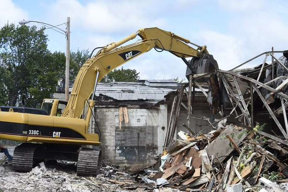 Jackson Demolition is pulling down 910 State St in Schenectady, NY., on Monday. City officials said they hope clearing the land will make it more appealing for redevelopment. (Skip Dickstein / Times Union)