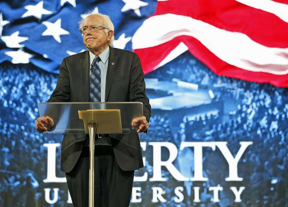 Democratic presidential hopeful Sen. Bernie Sanders of Vermont talks to stu dents at Liberty University, which was founded by the late Rev. Jerry Falwell. Photo: Steve Helber, Associated Press