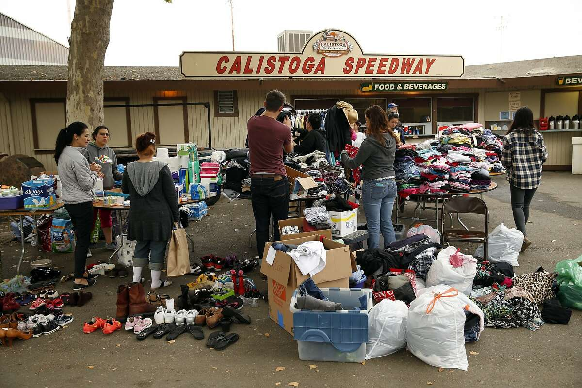 Valley Fire evacuees look through donated clothes at the Napa County Fairgrounds in Calistoga, Calif., on Monday, September 14, 2015.