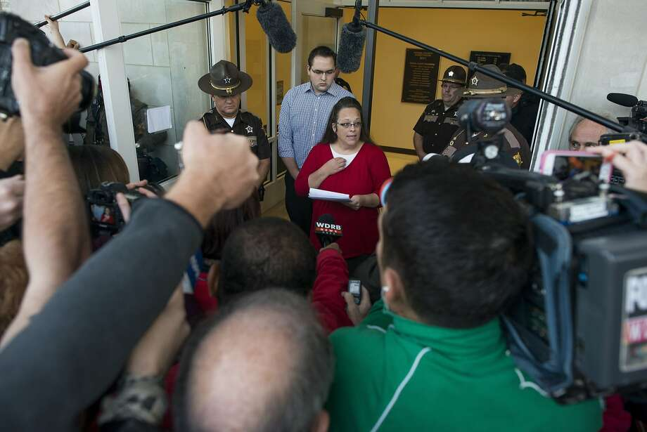 Rowan County Clerk Kim Davis gives a statement to the media on her first day back at work since being released from jail. Her deputy clerks continue to issue same-sex marriage licenses. Photo: Ty Wright, Getty Images