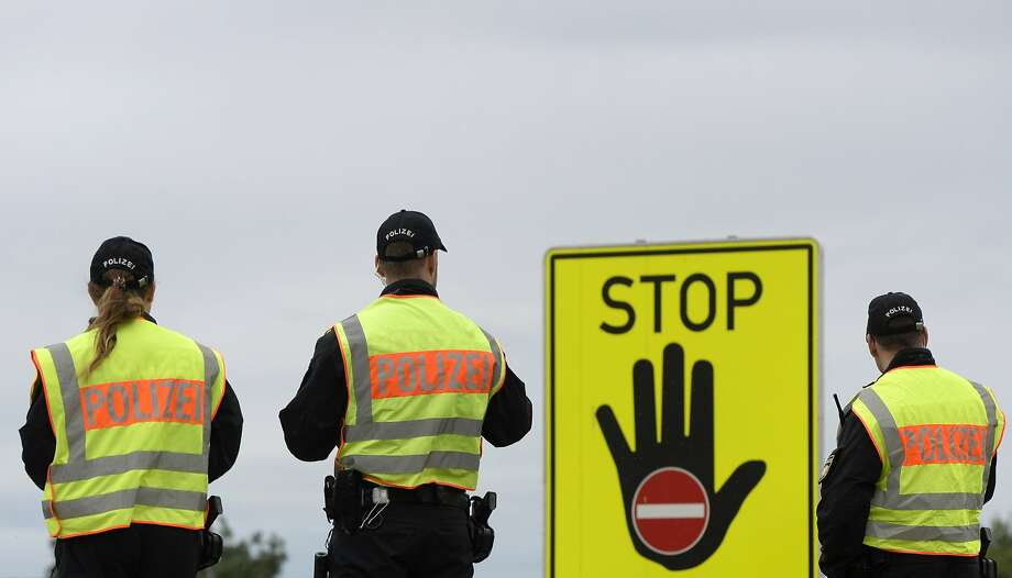 German police officers enforce passport control near Passau on a highway at the Austrian border. Photo: Christof Stache, AFP / Getty Images