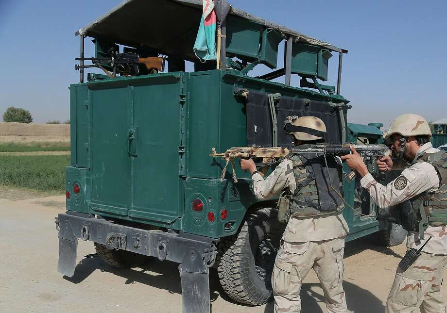 Afghan security forces take position near the main prison building after Taliban insurgents set off a car bomb and stormed the center in Ghazni. Photo: Rahmatullah Alizadah, AFP / Getty Images