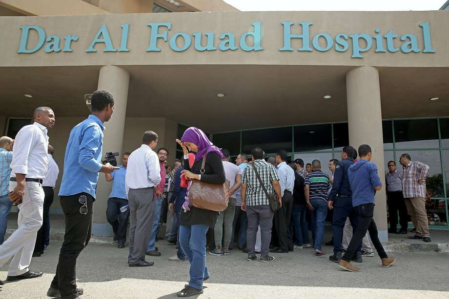 Egyptian journalists wait outside a Cairo hospital for details on tourists on a safari who were inadvertently attacked by security forces seeking militants. Photo: Nariman El-Mofty, Associated Press