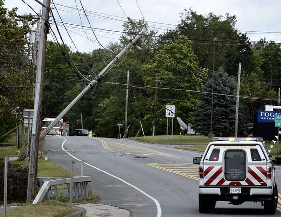 A downed pole came down on Route 50 on Monday, forcing authorities to close the busy route between Pashley and Paradowski roads. (Skip Dickstein / Times Union)