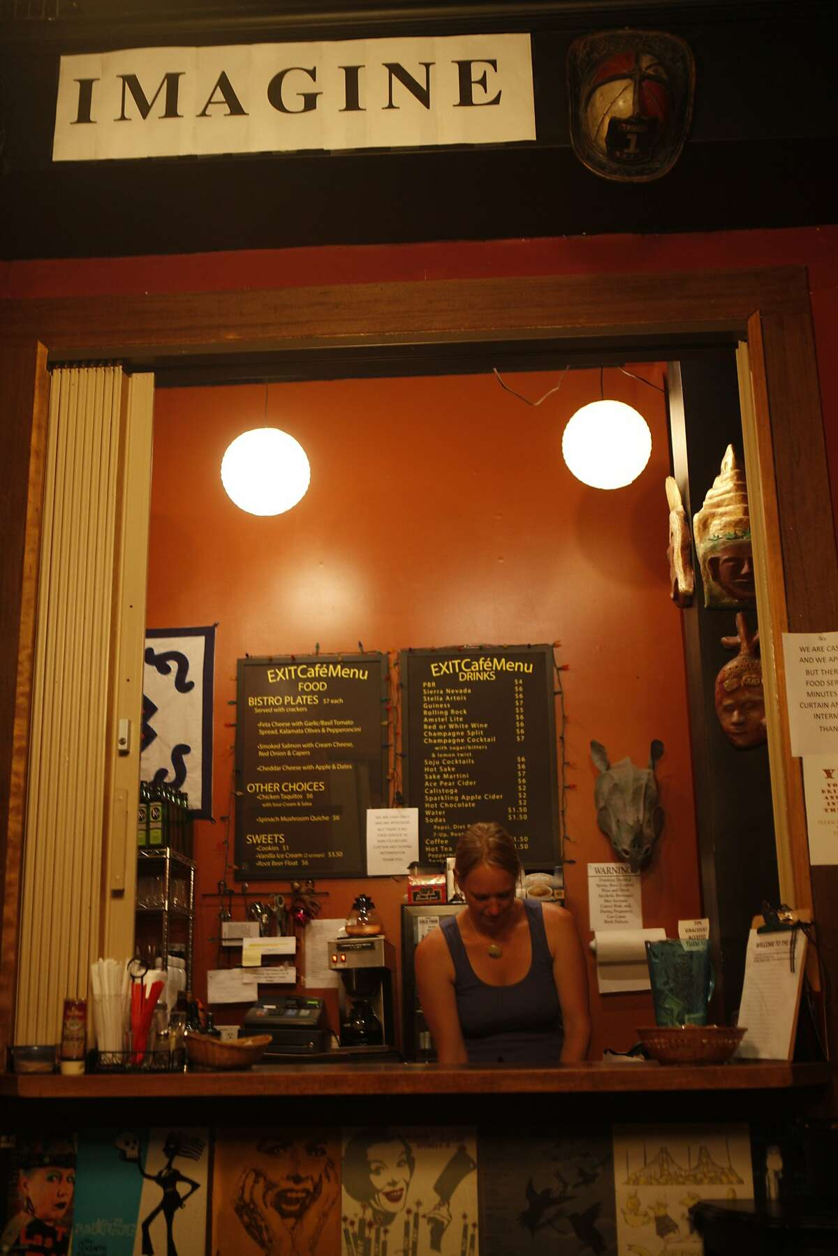Inside the Exit Theater, Charlynn serves coffee and treats at the full service cafe, Imagine, while patrons wait to see performances at the San Francisco Fringe Festival September 12, 2015.