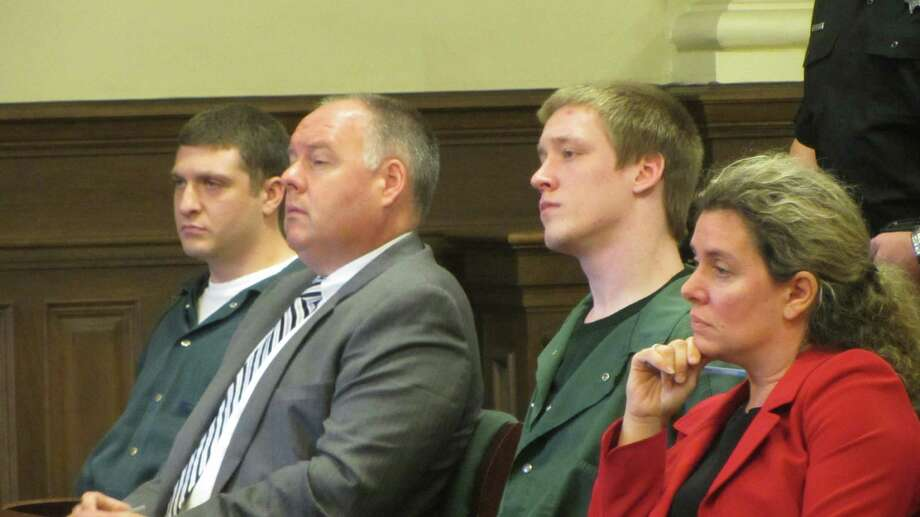 From right to left, attorney Danielle Neroni-Reilly, suspect David Stanley, attorney Rob Molloy and suspect Tyler Smith sit in Rensselaer County Court on Monday, Sept. 14, 2015, in Troy, NY. (Bob Gardinier / Times Union)