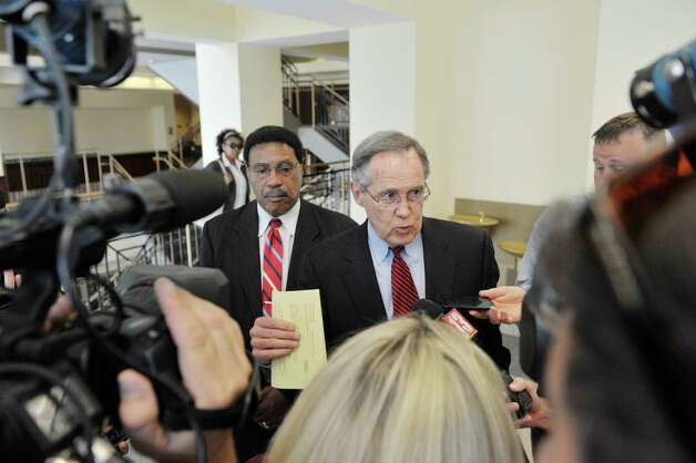 Former state Assemblyman William Scarborough, left, and his attorney E. Stewart Jones talk to members of the media at Albany County Court following Scarborough's sentencing on Monday, Sept. 14, 2015, in Albany, N.Y. (Paul Buckowski / Times Union) Photo: PAUL BUCKOWSKI / 00033343A