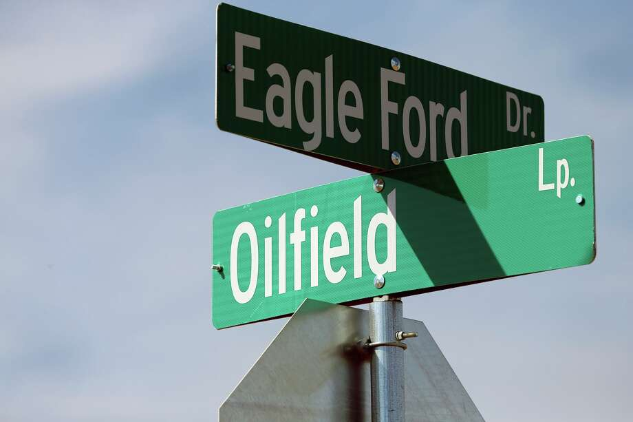 A quiet effort to lease around 150,000 acres in South Texas in 2007 was the beginning of one of the biggest developments in Texas oil and gas in decades: the Eagle Ford Shale. Some of the roads in the Garros Subdivision in Cotulla sport an appropriate names. Photo: Tom Reel /San Antonio Express-News / ©2012 San Antono Express-News