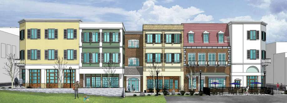 This rendering from Antinozzi Associates shows what a new building to be constructed between Fairfield Avenue and Elm Street in Bridgeport will look like when completed. Fairfield Avenue is at right. The project will include a walkway between the two streets, with businesses fronting on the passage. Photo: / Contributed Photo