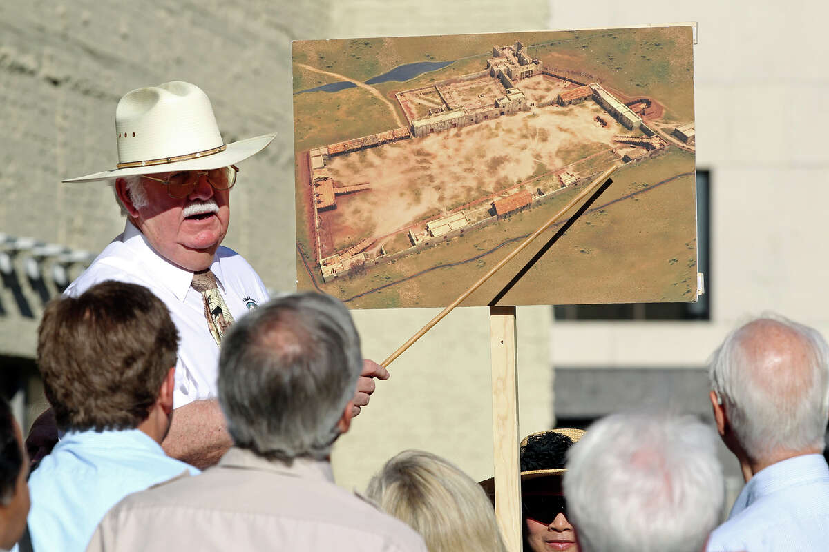 John L. Hinnant points out locations on a drawing of the original Alamo compound boundaries as the city's Alamo Plaza Commission tours the site in May 2014.