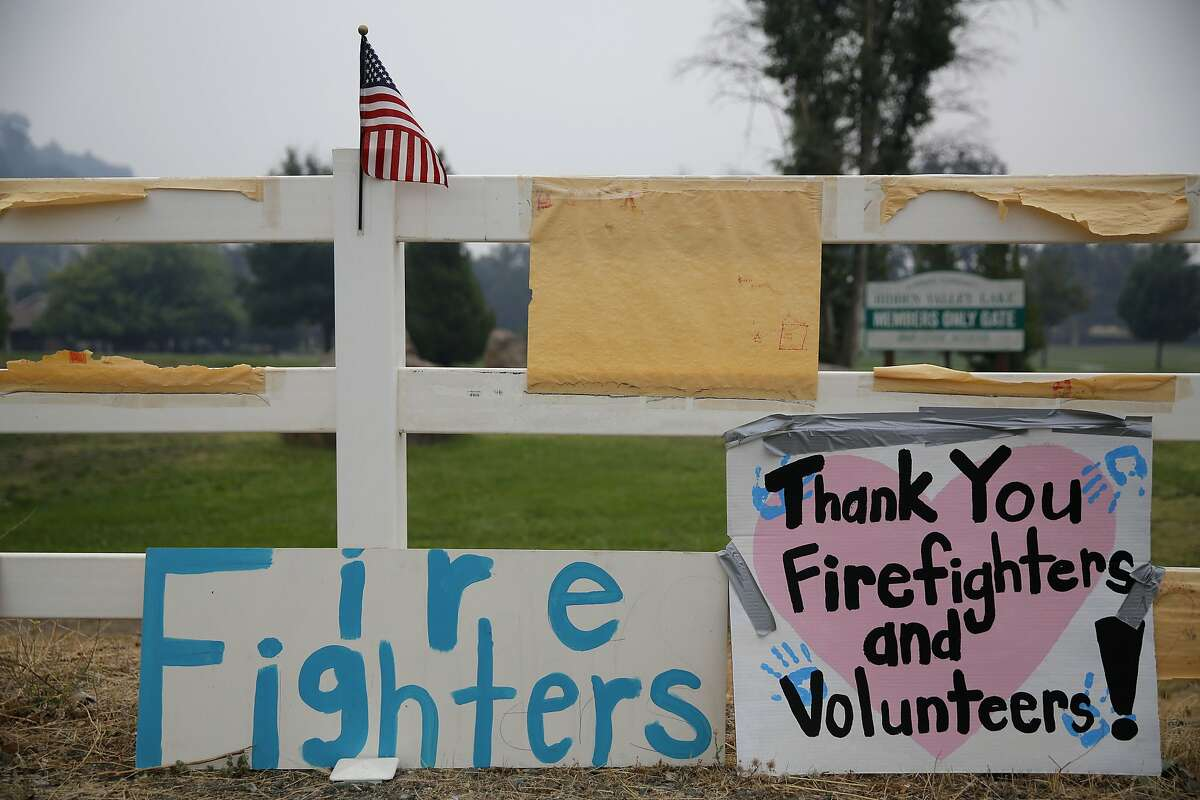 Signs thanking firefighters on a fence beside Highway 29 near Middletown, California, on Monday, Sept. 14, 2015.