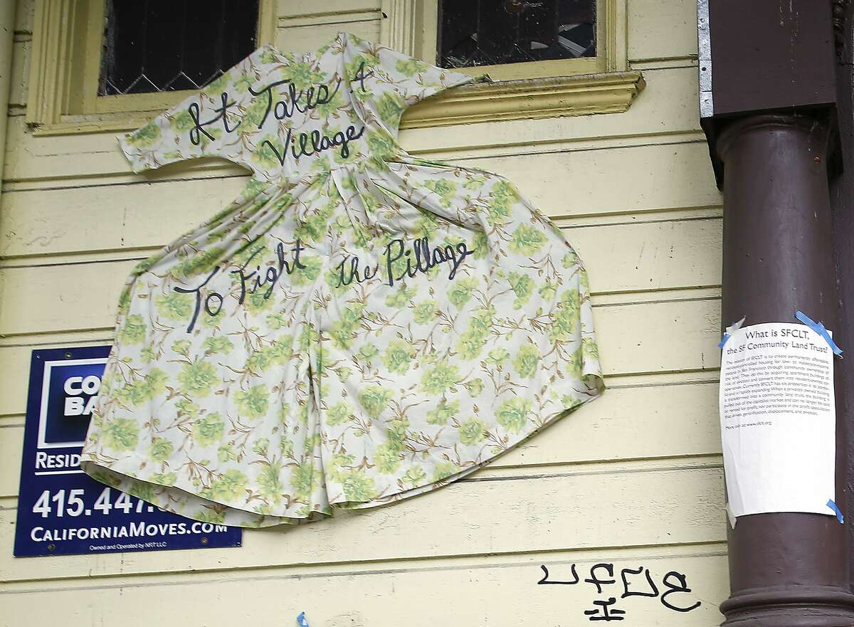 A dress covers part of a for sale sign outside of a residential building where the city provided a $2 million loan so a nonprofit could purchase the historic six flat unit in San Francisco, Calif., on Monday, September 14, 2015.