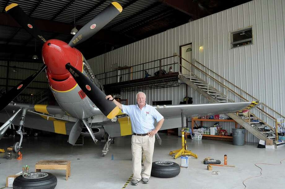 Terry Sonday just goes up the stairs to the right to his home at David Wayne Hooks Memorial Airport. With him is a P-51 fighter. Photo: Dave Rossman, Freelance / Freelalnce