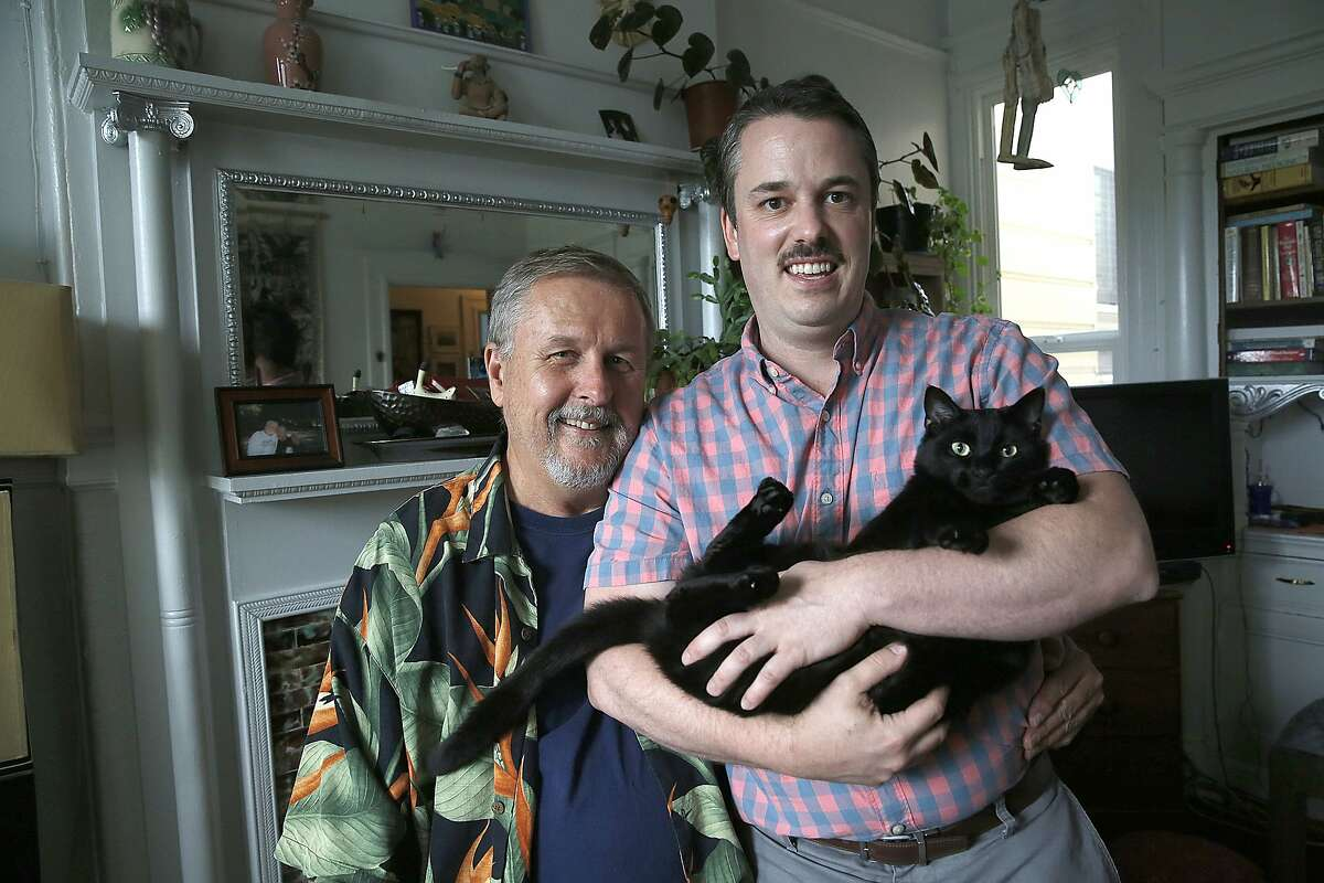 Tenants Ed Wolf (left) and Kirk Read (right) talk about nearly being evicted until the city stepped in to provide a $2 million loan so a nonprofit could purchase the historic six flat unit in San Francisco, Calif., on Monday, September 14, 2015. Read is carrying their cat Dewey.