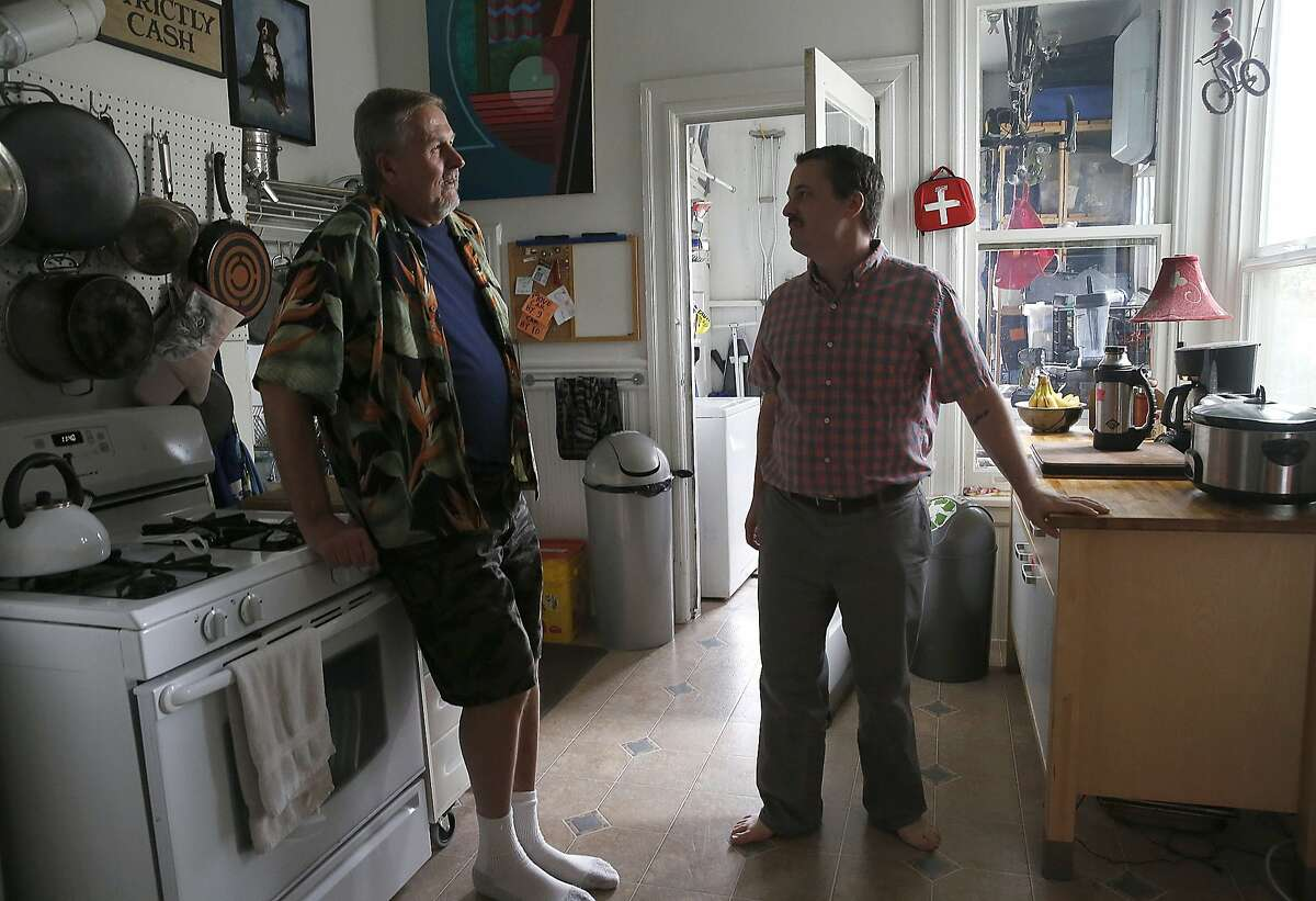 Tenants Ed Wolf (left) and Kirk Read (right) talk about nearly being evicted until the city stepped in to provide a $2 million loan so a nonprofit could purchase the historic six flat unit in San Francisco, Calif., on Monday, September 14, 2015.