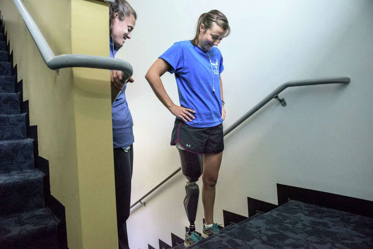 Christy Wise, 28, a pilot in the Air Force, looks at the last few steps to climb with physical therapist Alicia White, at the Center for the Intrepid in San Antonio on July 13. Wise, in the military for 10 years and a helicopter pilot for six, lost her leg above the knee in a boating accident in Florida a few months back.