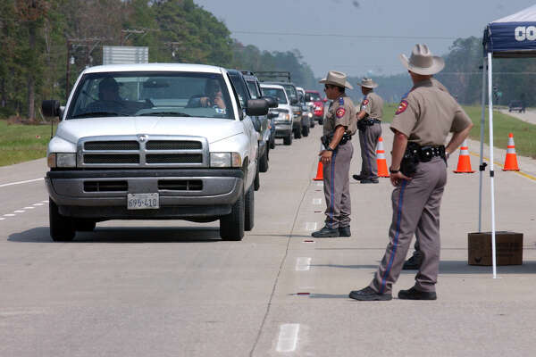 Texas Department of Public Safety troopers manned a road block on Southbound U.S. Highway 96 near Evadale, which led back into Beaumont, on Sept 29, 2005. Officials closed roads and barred residents from returning to their homes several days after Hurricane Rita hit.