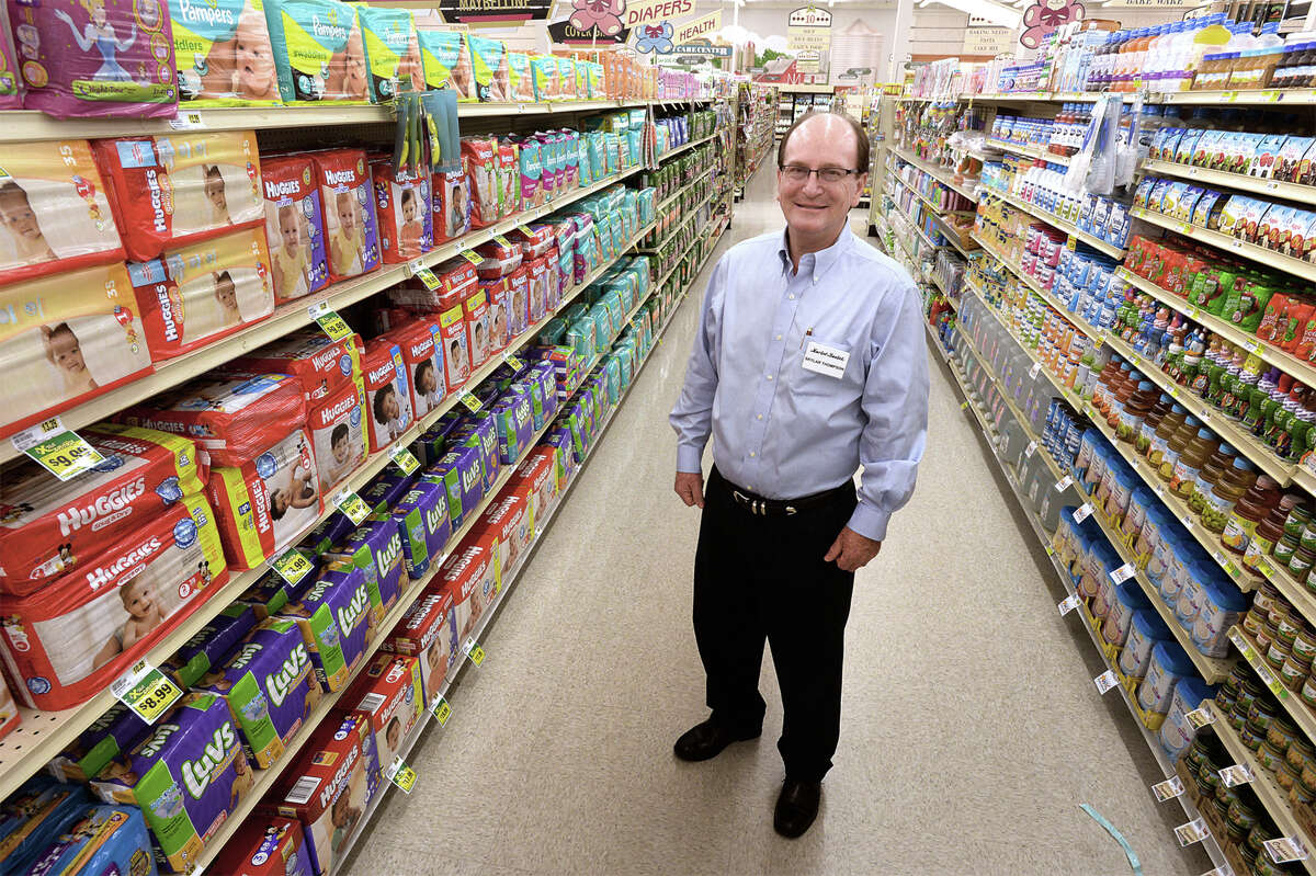 Market Basket President Skylar Thompson stands on the diaper aisle at the Market Basket on Phelan Boulevard in Beaumont, where he slept several nights after Hurricane Rita struck. Thompson said he selected the aisle for its view of the front doors.