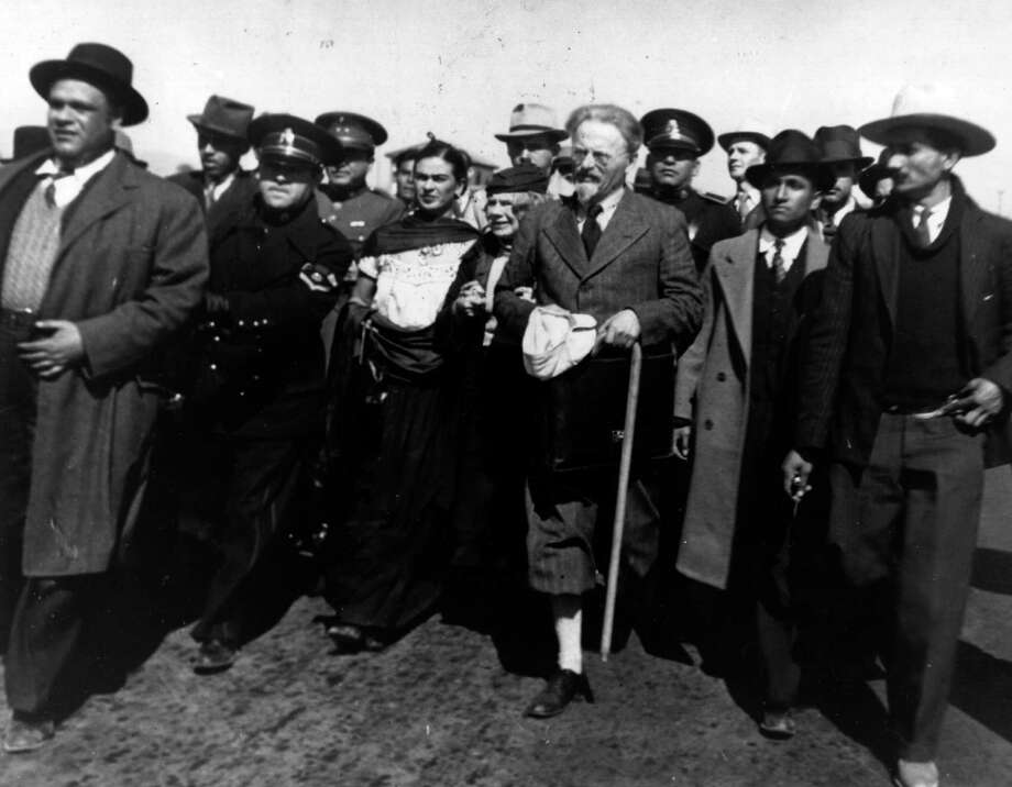 January 1937: Leon Trotsky arrives in Tampico, Mexico, surrounded by plainclothes policemen, with his wife (behind left), and Mexican artists Frida Kahlo and Diego Rivera, left. Photo: Keystone, Getty Images / Hulton Archive