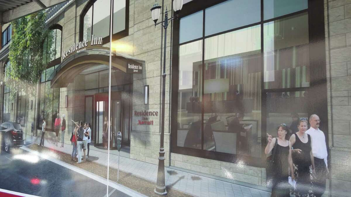 A sidewalk rendering illustrates for pedestrians the Residence Inn planned for downtown Stamford, Conn., among multiple new hotels in the pipeline for Fairfield County.