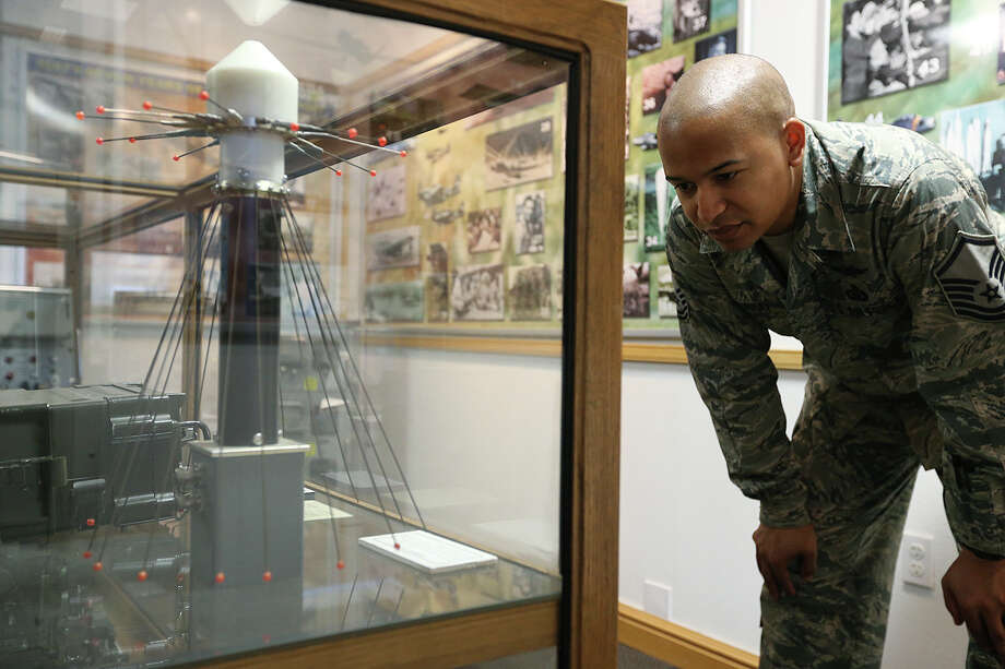U.S. Air Force Master Sgt. Kirk Murray, 34, checks out a Tempest antenna at the Heritage Center of the U.S. Air Force Intelligence Surveillance Reconnaissance Agency at Lackland Air Force Security Hill, July 16. Photo: Jerry Lara /San Antonio Express-News / © 2015 San Antonio Express-News