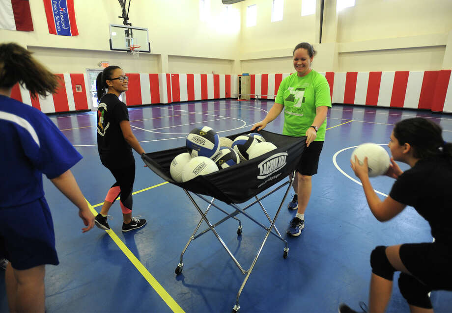 Angela Luce, center, works with students during volleyball at Harmony Science Academy-Beaumont on Thursday. Photo taken Thursday, September 10, 2015 Guiseppe Barranco/The Enterprise Photo: Guiseppe Barranco, Photo Editor