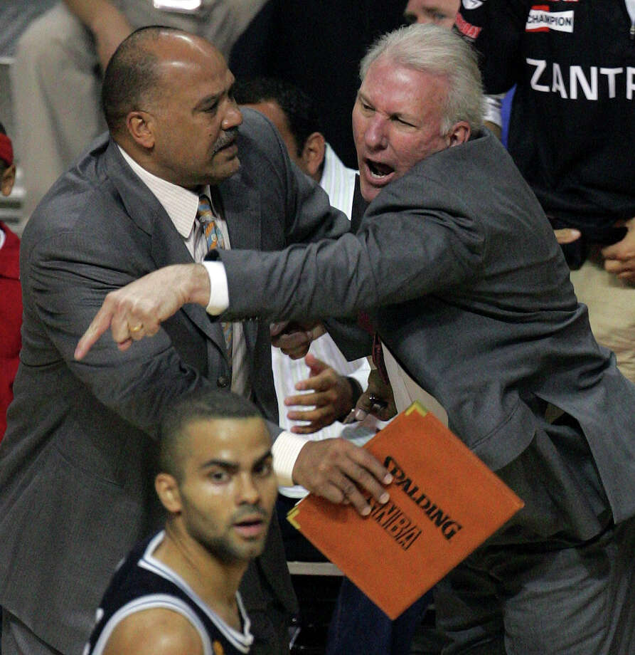 Spurs coach Gregg Popovich reacts to a technical foul called against him as assistant coach Don Newman holds him back during first quarter action of Game 4 of the NBA Finals at The Palace of Auburn Hills near Detroit on June 16, 2005. Photo: Kin Man Hui /San Antonio Express-News / SAN ANTONIO EXPRESS-NEWS