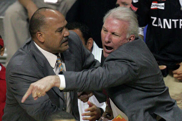 Spurs coach Gregg Popovich reacts to a technical foul called against him as assistant coach Don Newman holds him back during first quarter action of Game 4 of the NBA Finals at The Palace of Auburn Hills near Detroit on June 16, 2005.