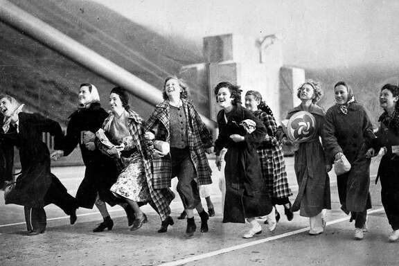 Nine girls from San Rafael High School crossing the Golden Gate Bridge on open day May 23,1937