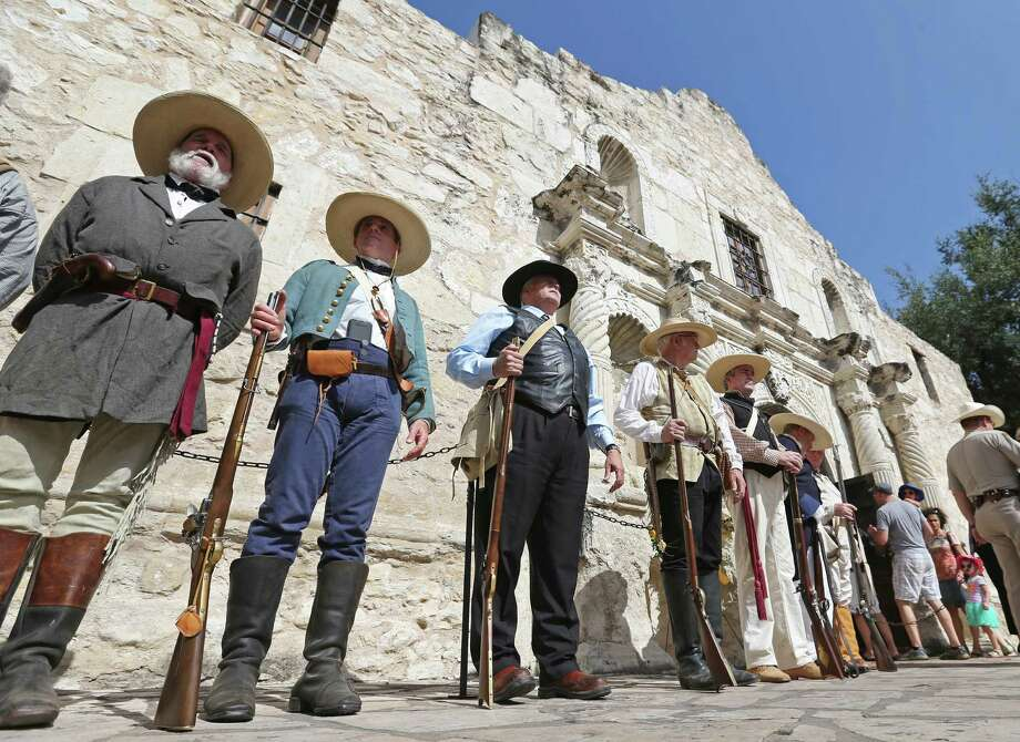 Members of The Texas Army take part in a ceremony ending the Daughters of the Republic of Texas' 110-year custodianship of the Alamo on July 10. Photo: Edward A. Ornelas /San Antonio Express-News / © 2015 San Antonio Express-News