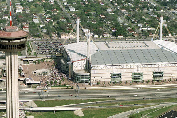San Antonio's Tower of the Americas stands in front of the Alamodome in 1998 during the NCAA Men's Final Four.