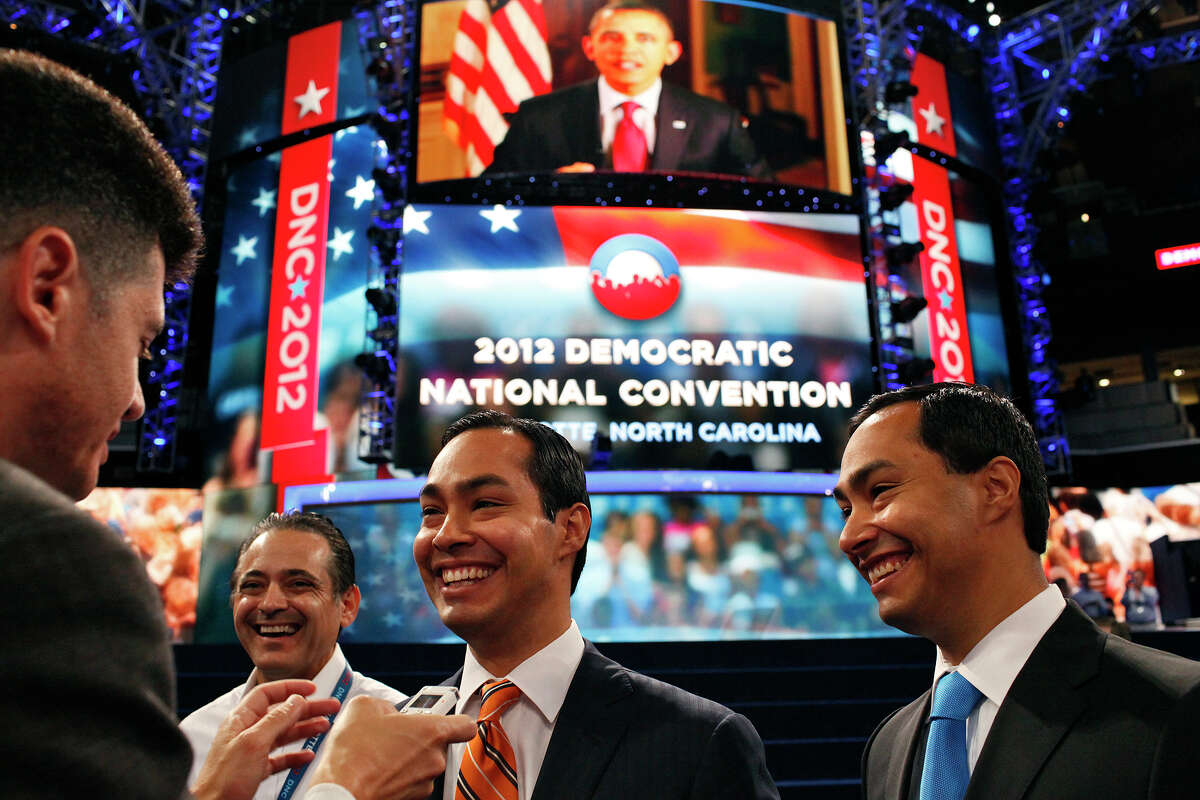 Mayor Julián Castro, center, and his brother, Joaquin Castro, are interviewed in Time Warner Arena as they prepare for the Democratic National Convention in Charlotte, N.C., on Sept. 3, 2012.