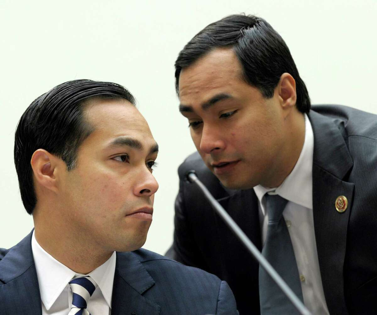 San Antonio Mayor Julián Castro (left) talks with his brother Rep. Joaquin Castro, D-Texas, right, on Capitol Hill in Washington, D.C., Feb. 5, 2013, prior to testifying before the House Judiciary Committee hearing on America's Immigration System: Opportunities for Legal Immigration and Enforcement of Laws against Illegal Immigration.