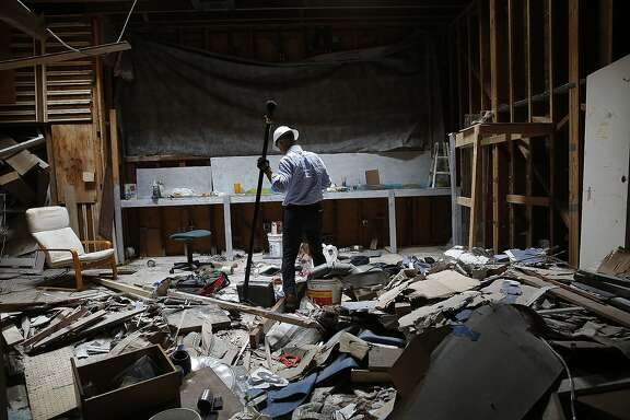 Businessman Walter Dawdiak shows a vacant building used by smash-and-grabbers to sort their stuff in San Francisco, Calif., on Monday, September 14, 2015.