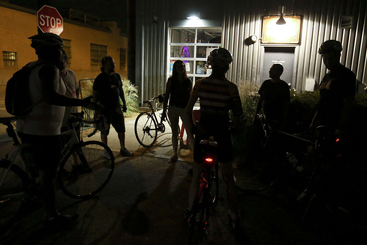 Cyclists gather at Bike World at The Pearl after a Thursday night social.