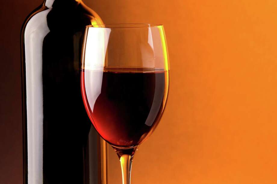 red wine glass bottle; wine bottle / handout / stock agency